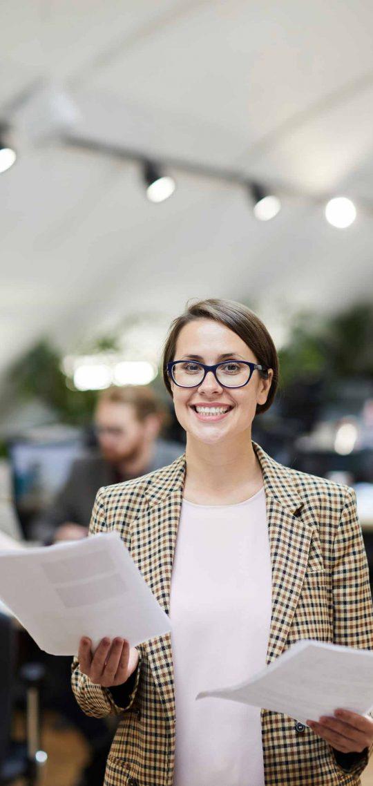 smiling-businesswoman-posing-3K6AX8Q.jpg